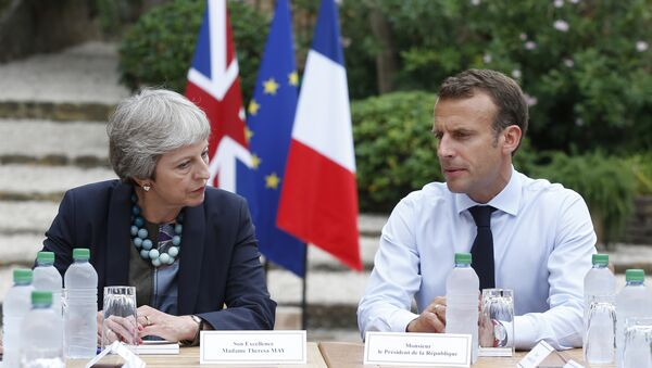 French President Emmanuel Macron, right, meets with British Prime Minister Theresa May to discuss Brexit issues at the Fort de Bregancon in Bornes-les-Mimosas, southern France, Aug. 3, 2018 - Sputnik International