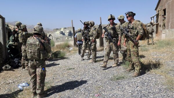U.S. military advisers from the 1st Security Force Assistance Brigade are seen at an Afghan National Army base in Maidan Wardak province, Afghanistan August 6, 2018 - Sputnik International