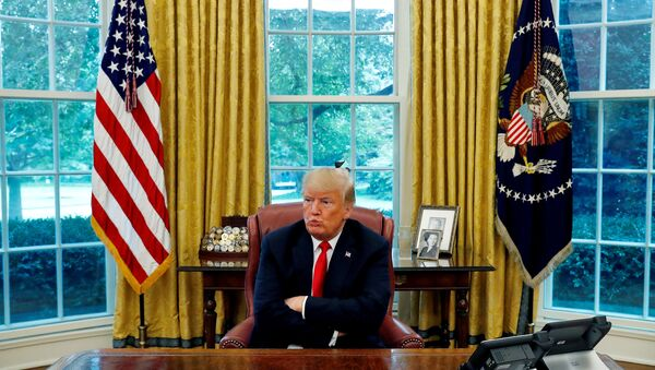 US President Donald Trump reacts to a question during an interview with Reuters in the Oval Office of the White House in Washington, U.S. August 20, 2018. - Sputnik International