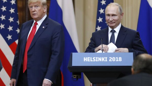 In this July 16, 2018, file photo, U.S. President Donald Trump, left, and Russian President Vladimir Putin arrive for a press conference after their meeting at the Presidential Palace in Helsinki, Finland. If Donald Trump is serious about his public courtship of Vladimir Putin, he may want to take pointers from one of the Russian leader's longtime suitors: Chinese President Xi Jinping. In this political love triangle, Putin and Xi are tied by strategic need and a rare dose of personal affection, while Trump's effusive display in Helsinki showed him as an earnest admirer of the man leading a country long considered America's adversary - Sputnik International