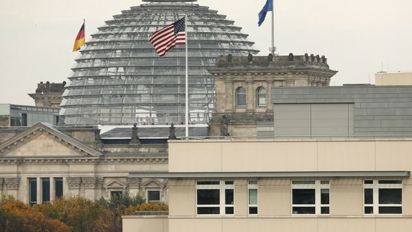 American flag flies on top of the U.S. embassy in front of the Reichstag building that houses the German Parliament, Bundestag, in Berlin, Germany (File) - Sputnik International