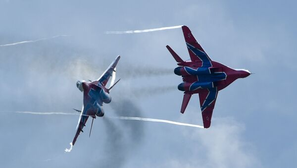 MiG-29 jet fighters of Russian aerobatic team Strizhi (Swifts) at the 4th international military technical forum Army 2018 - Sputnik International