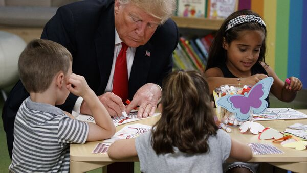 President Donald Trump colors pictures with a group of children at the Nationwide Children's Hospital, Friday, Aug. 24, 2018, in Columbus, Ohio - Sputnik International