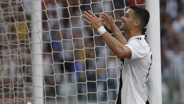 Juventus' Cristiano Ronaldo gestures towards the crowd after teammate Juventus' Mario Mandzukic scored his sides 2nd goal of the game during the Serie A soccer match between Juventus and Lazio at the Allianz Stadium in Turin, Italy, Saturday, Aug. 25, 2018 - Sputnik International