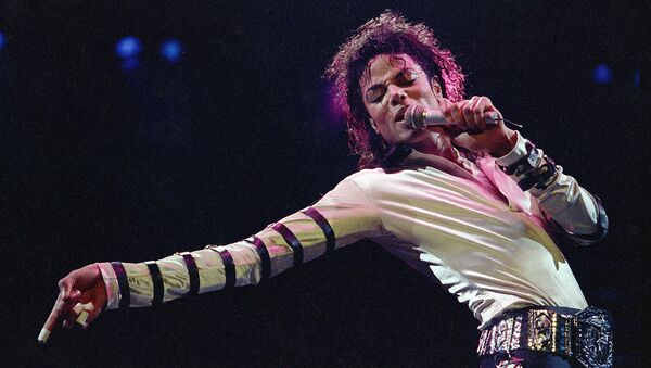 In this Feb. 24, 1988 file photo, Michael Jackson leans, points and sings, dances and struts during the opening performance of his 13-city U.S. tour, in Kansas City - Sputnik International