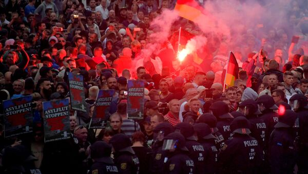 Right-wing supporters protest after a German man was stabbed last weekend in Chemnitz, Germany, August 27, 2018. - Sputnik International