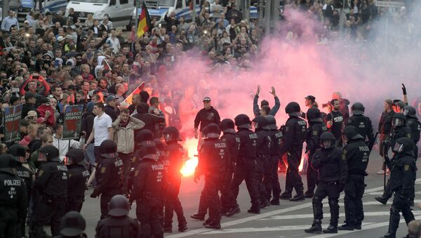 Protesters light fireworks during a far-right demonstration in Chemnitz, Germany, Monday, Aug. 27, 2018 after a man has died and two others were injured in an altercation between several people of various nationalities in the eastern German city of Chemnitz on Sunday - Sputnik International