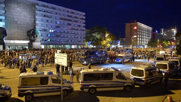 Police vehicles are seen as right-wing supporters protest after a German man was stabbed last weekend in Chemnitz, Germany, August 27, 2018 - Sputnik International