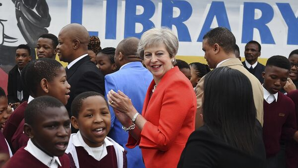 British Prime Minister Theresa May meets pupils during a visit at the the ID Mkhize High School in Gugulethu, Cape Town, South Africa, Tuesday, Aug. 28, 2018. Theresa May has started a three-nation visit to Africa where she is to meet South African President Cyril Ramaphosa - Sputnik International