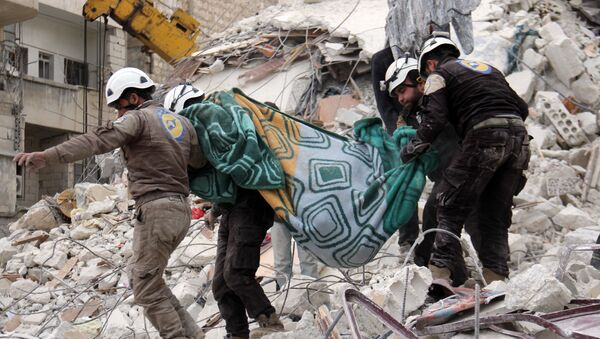 Syrian civil defence volunteers, known as the White Helmets, carry a body retrieved from the rubble following reported government airstrike on the Syrian town of Ariha, in the northwestern province of Idlib, on February 27, 2017 - Sputnik International