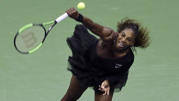 Serena Williams, of the United States, serves to Magda Linette, of Poland, during the first round of the U.S. Open tennis tournament, Monday, Aug. 27, 2018, in New York - Sputnik International