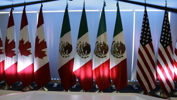 National flags representing Canada, Mexico, and the US are lit by stage lights at the North American Free Trade Agreement, NAFTA, renegotiations, in Mexico City, Tuesday, Sept. 5, 2017. - Sputnik International