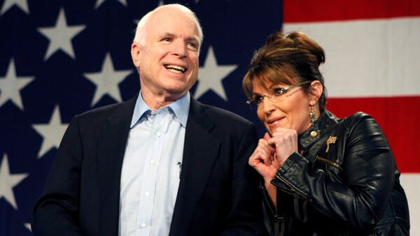 U.S. Senator John McCain (R-AZ) and former Alaska Governor and vice presidential candidate Sarah Palin acknowledge the crowd during a campaign rally for McCain at the Pima County Fairgrounds in Tucson, Arizona March 26, 2010 - Sputnik International