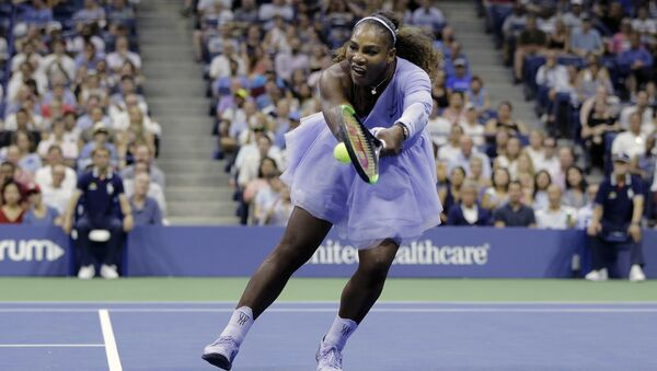Serena Williams returns a shot to Carina Witthoeft, of Germany, during the second round of the U.S. Open tennis tournament, Wednesday, Aug. 29, 2018, in New York. - Sputnik International