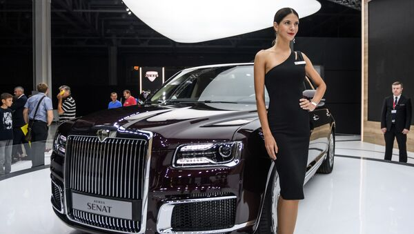 A model poses at the Aurus company stand during the 2018 Moscow International Auto Show. - Sputnik International