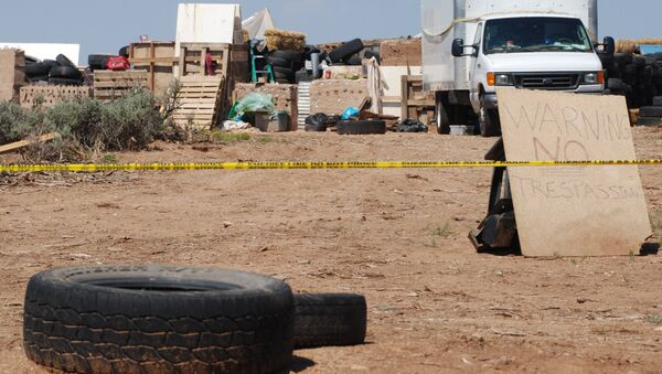 Police tape restricts access to a disheveled living compound in Amalia, N.M., on Tuesday, Aug. 7, 2018. - Sputnik International