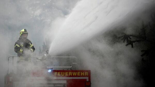 Firefighters help to put out a forest fire near Treuenbrietzen, Germany August 24, 2018. - Sputnik International