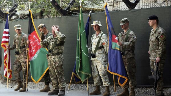 Afghanistan and NATO soldiers hold their flags before the start of the change of command ceremony at Resolute Support headquarters, in Kabul, Afghanistan, Sunday, Sept. 2, 2018 - Sputnik International
