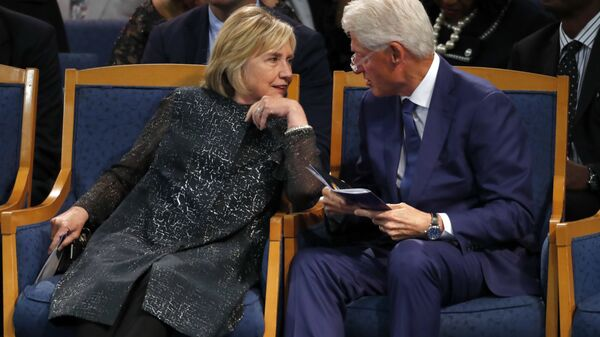 Former President Bill Clinton and wife Hillary Clinton, left, talking during the funeral service for Aretha Franklin at Greater Grace Temple, Friday, Aug. 31, 2018, in Detroit - Sputnik International