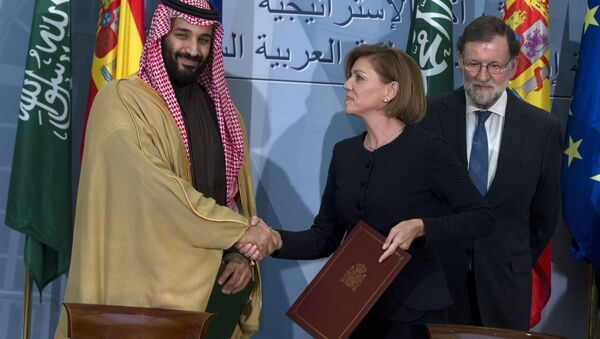 FILE - In this April 12, 2018 file photo, Saudi Arabia Crown Prince Mohammed bin Salman, left and Spain's then Defense Minister Maria Dolores Cospedal shake hands after signing bi-lateral agreements in the presence of the then Prime Minister of Spain Mariano Rajoy, right, at the Moncloa Palace in Madrid, Spain. Spain has cancelled the sale of 400 laser-guided bombs to Saudi Arabia it was reported Tuesday Sept. 4, 2018, amid fears that the weapons could be used in the Riyadh-led coalition fighting the Iran-aligned Houthi rebels in Yemen - Sputnik International