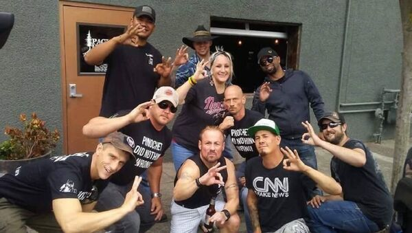 Patriot Prayer + Proud Boys in Vancouver night b4 Aug 4 Portland rally many fear will end in violence. Tusitala Tiny Toese and others make an apparent White Power hand gesture. T-shirts read, Pinochet Did Nothing Wrong. - Sputnik International