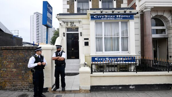 Police officers stand outside the City Stay Hotel used by Alexander Petrov and Ruslan Boshirov; who have been accused of attempting to murder former Russian spy Sergei Skripal and his daughter Yulia; in London, Britain September 5, 2018 - Sputnik International