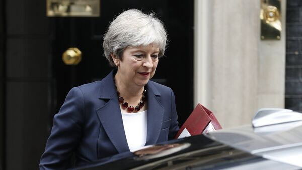 Britain's Prime Minister Theresa May leaves 10 Downing street to take part in Prime Ministers questions at the House of Commons in London on September 5, 2018. - Sputnik International
