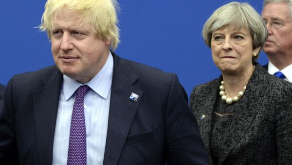 In this Thursday, May 25, 2017 file photo British Foreign Secretary Boris Johnson, left, and Britain's Prime Minister Theresa May arrive for a meeting during the NATO summit of heads of state and government, at the NATO headquarters, in Brussels. British ex-Foreign Secretary Boris Johnson has slammed Prime Minister Theresa May's Brexit policy, a move likely to fuel speculation that he is seeking to oust her. Johnson wrote in the Daily Telegraph on Monday Sept. 3, 2018 that May's so-called Chequers plan for continued ties with the European Union after Brexit will leave Britain in a weakened position - Sputnik International