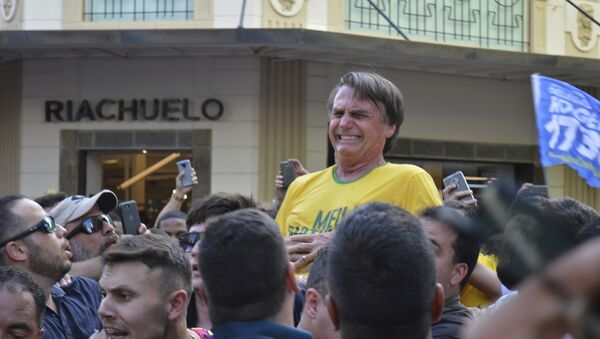 Presidential candidate Jair Bolsonaro grimaces right after being stabbed in the stomach during a campaign rally in Juiz de Fora, Brazil, Thursday, Sept. 6, 2018 - Sputnik International
