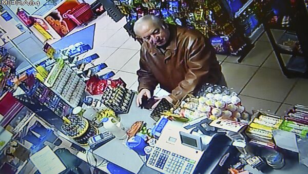 A still image from CCTV footage recorded on February 27, 2018 shows former Russian spy Sergei Skripal buying groceries at the Bargain Stop convenience store in Salisbury on February 27, 2018. - Sputnik International