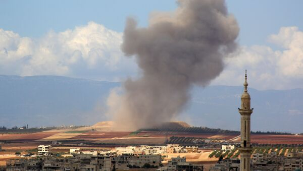 Smoke raises in the Syrian village of Kafr Ain in the southern countryside of Idlib province after an airstrike on September 7, 2018 - Sputnik International