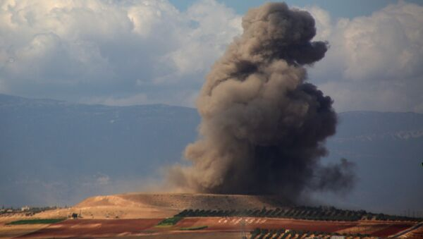 Smoke rises near the Syrian village of Kafr Ain in the southern countryside of Idlib province after an airstrike on September 7, 2018 - Sputnik International
