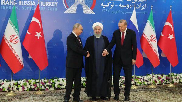 Russian President Vladimir Putin, Iranian President Hassan Rouhani, and Turkish President Recep Tayyip Erdogan during trilateral talks in Tehran. - Sputnik International