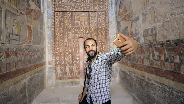 A man takes a selfie in a chamber of the tomb of Mehu, after it was opened for the public at Saqqara area near Egypt's Saqqara necropolis, in Giza, Egypt September 8, 2018. - Sputnik International