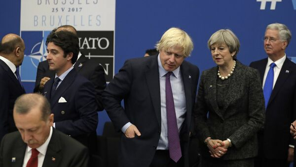 British Prime Minister Theresa May and British Foreign Minister Boris Johnson look toward Turkish President Recep Tayyip Erdogan, right, as they participate in a working dinner meeting at the NATO headquarters during a NATO summit of heads of state and government in Brussels on Thursday, May 25, 2017 - Sputnik International