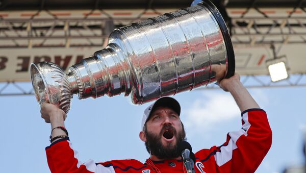 Washington Capitals forward Alex Ovechkin (8), of Russia, holds up the Stanley Cup for fans to see during the NHL hockey team's Stanley Cup victory celebration at the National Mall in Washington, Tuesday, June 12, 2018 - Sputnik International