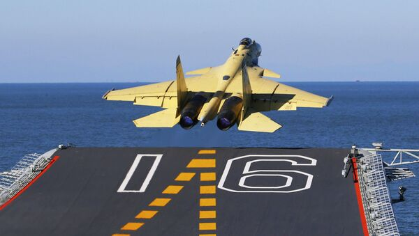 A carrier-borne J-15 fighter jet takes off from China's first aircraft carrier, the Liaoning (File) - Sputnik International