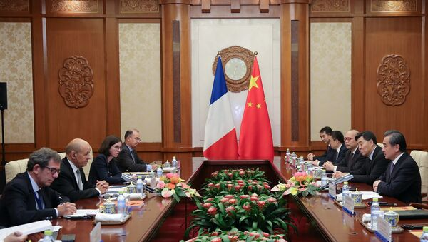 China's Foreign Minister Wang Yi meets with France's Foreign Affairs Minister Jean-Yves Le Drian at Diaoyutai State Guesthouse in Beijing, China September 13, 2018 - Sputnik International