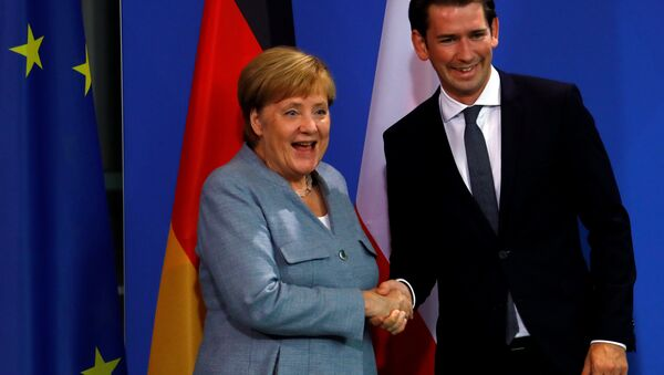German Chancellor Angela Merkel and Austrian Chancellor Sebastian Kurz shake hands after giving a statment to the media in the chancellery in Berlin, Germany, September 16, 2018. - Sputnik International