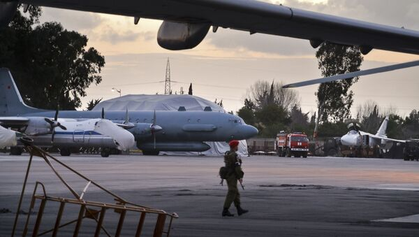 In this photo taken on Friday, March 4, 2016, A Russian military police officer stands guard at the Russian air base in Hemeimeem, Syria, with an Il-20 electronic intelligence plane of the Russian air force is in the background. An Il-20 aircraft was shot down Tuesday, Sept. 18, 2018 by a Syrian missile over the Mediterranean Sea, killing all 15 people on board, as the Syrian military fired on Israeli fighter jets attacking targets in northwestern Syria - Sputnik International