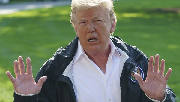 President Donald Trump talks to media before boarding Marine One on the South Lawn of the White House in Washington, Wednesday, Sept. 19, 2018, for the short trip to Andrews Air Force Base en route to Havelock, N.C. - Sputnik International