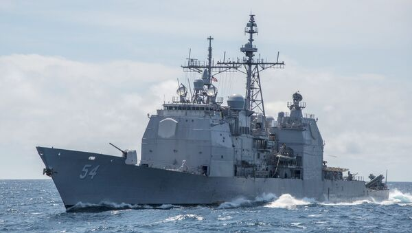 """This Mar. 6, 2016, file photo provided by the U.S. Navy, shows the Ticonderoga-class guided-missile cruiser USS Antietam (CG 54) sails in the South China Sea. China says it dispatched warships to identify and warn off a pair of U.S. Navy vessels sailing near one of its island claims in the South China Sea. A statement on the Defense Ministry's website said the Arleigh Burke class guided-missile destroyer USS Higgins and Ticonderoga class guided-missile cruiser USS Antietam entered waters China claims in the Paracel island group """"without the permission of the Chinese government."""" - Sputnik International"""