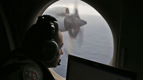 FILE - In this March 22, 2014 file photo, flight officer Rayan Gharazeddine on board a Royal Australian Air Force AP-3C Orion, searches for the missing Malaysia Airlines Flight MH370 in southern Indian Ocean, Australia - Sputnik International