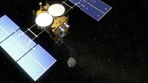 The Hayabusa 2 probe and an asteroid - visualization - Sputnik International