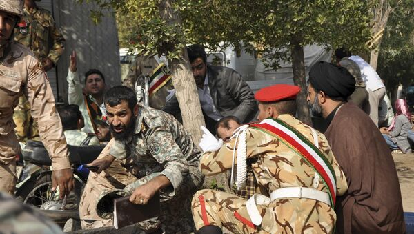 Iranian armed forces members and civilians take shelter in a shooting during a military parade marking the 38th anniversary of Iraq's 1980 invasion of Iran - Sputnik International