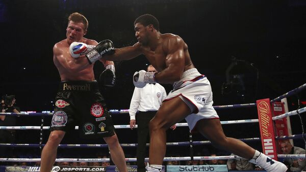 Britain's Anthony Joshua, right, lands a blow on Alexander Povetkin on his way to retaining his WBA, IBF, and WBO heavyweight boxing titles, Saturday, Sept. 22, 2018, at Wembley Stadium in London. - Sputnik International