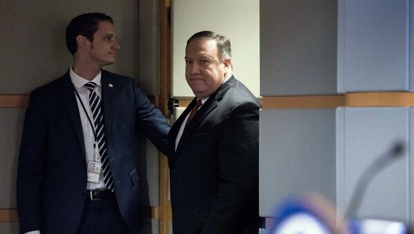 Secretary of State Mike Pompeo arrives at a news conference in the press briefing room at the State Department in Washington - Sputnik International