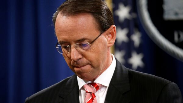 Deputy U.S. Attorney General Rod Rosenstein pauses while announcing grand jury indictments of 12 Russian intelligence officers in special counsel Robert Mueller's Russia investigation, during a news conference at the Justice Department in Washington, U.S., July 13, 2018 - Sputnik International