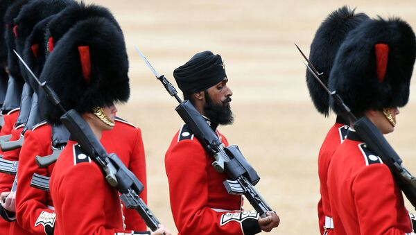 A Sikh member of the Coldstream Guards, center, wears a turban as he takes part in the Colonel's Review, the final rehearsal for Trooping the Colour, the Queen's annual birthday parade, in London, Saturday, June 2, 2018. - Sputnik International