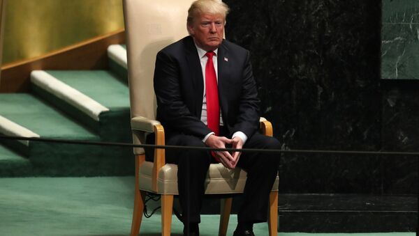 U.S. President Donald Trump sits in the chair reserved for heads of state before delivering his address during the 73rd session of the United Nations General Assembly at U.N. headquarters in New York, U.S., September 25, 2018 - Sputnik International